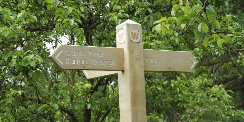 Barton Seagrave Parish sign to nearby places